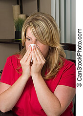 woman blowing her nose