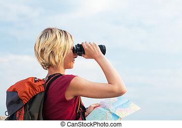 woman hiking - young blonde woman hiking watching through...