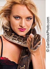 young blonde woman holding serpent