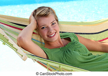 young blonde woman in a hammock