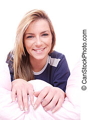 Blonde woman in bed