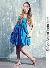 young blonde woman in blue dress