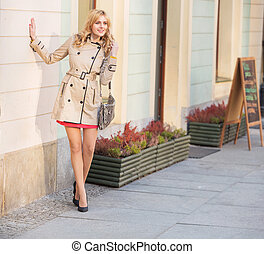 Young blonde woman in the old town