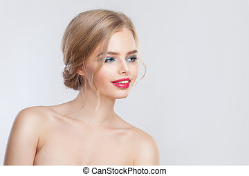 Young blonde woman looking a side on white background