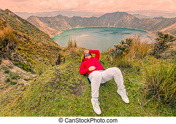 Woman Lying On The Ground Near Edge Of Quilotoa Lake