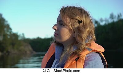 Young blonde woman on a boat