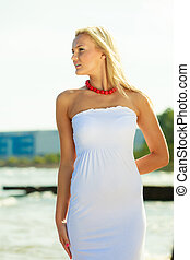Young blonde woman on beach.