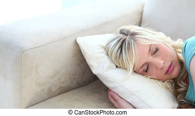Young blonde woman sleeping