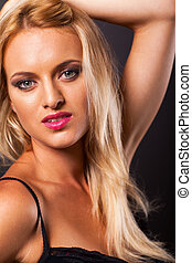 young blonde woman studio portrait