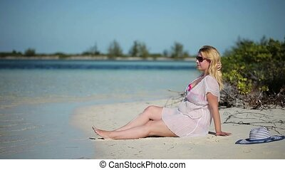 Young blonde woman sunbathing