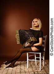 Young blonde woman with accordion
