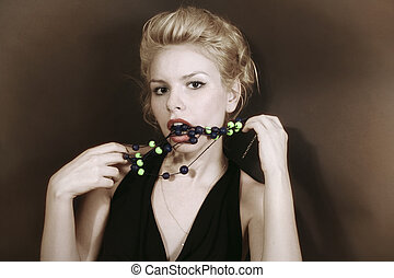 Young blonde woman with beads