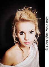 Young blonde woman with beautiful hairstyle