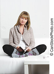 Young blonde woman with book