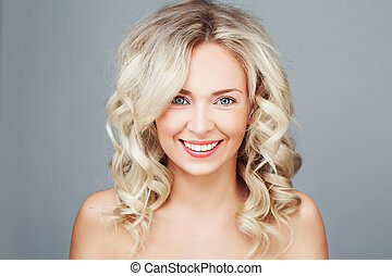 Young Blonde Woman with Curly Hair Smiling. Happy Fashion Model Closeup
