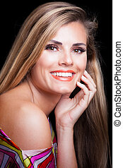 young blonde woman with perfect white smile studio shot