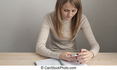 Young blonde woman with smartphone