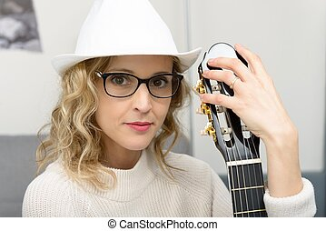 young blonde woman with the acoustic guitar
