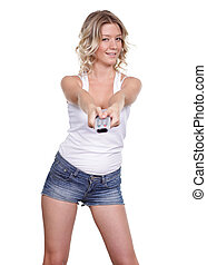 Young blonde woman with TV remote control