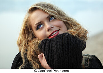 young blound woman in black scarf