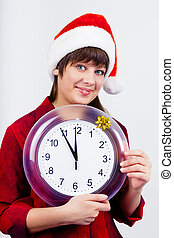 blue-eyed beautiful girl in santa hat with clock