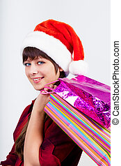 blue-eyed beautiful girl in santa hat with presents