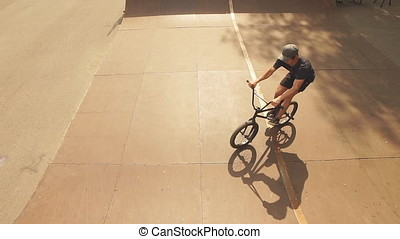 BMX bicycle rider doing trick on his bicycle - Young BMX...