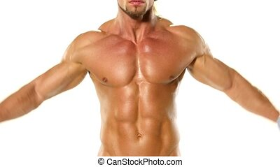Young bodybuilder athlete trains muscles closeup on white background