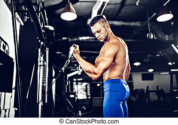 Young Bodybuilder Doing Exercise For Biceps