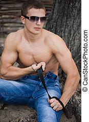 young bodybuilder man in street