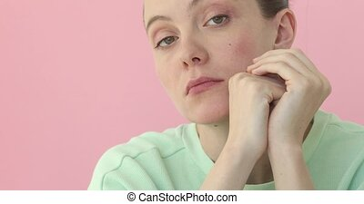Young bored woman closeup at pink background - Young bored...