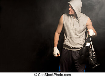 Young boxer arriving for a fight