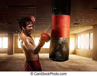 Young boxer exercising with punching the bag