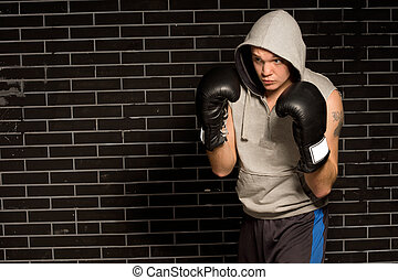 Young boxer training for a fight