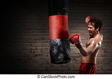 Young boxer training with punching the bag