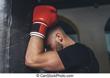young boxer with punching bag