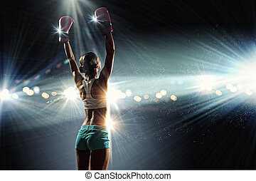 Young boxer woman - Young pretty boxer woman standing in...