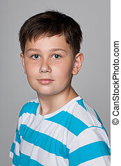 Young boy against the gray background