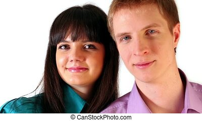 Young boy and girl look and smile