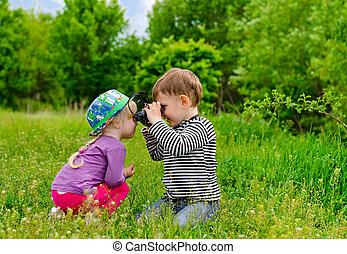 Young boy and girl playing with binoculars