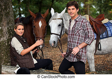 young boy and girl riding horses
