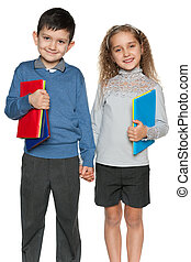 Young boy and girl with books