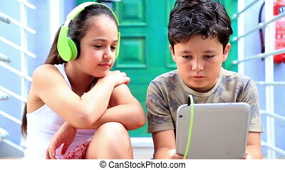 Young boy and girl with digital tablet 2