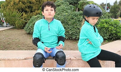 Young boy and girl with skate