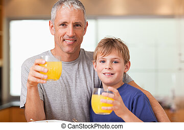 Young boy and his father having breakfast