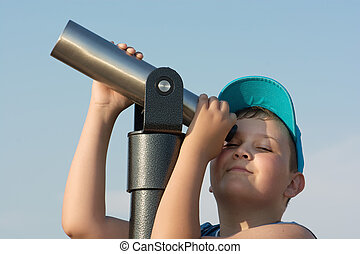 Young boy and telescope
