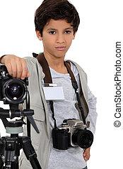 Young boy as a press photographer