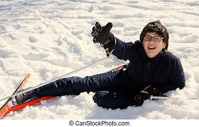 boy asks for help after the fall on skis