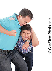 Young boy being aggressively held up by his father