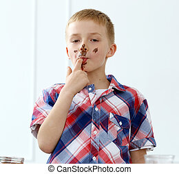 Young boy by the table